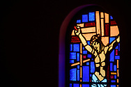 Stained glass depicting Jesus Christ at the crucifixion on the cross, seen on Saturday, April 17, 2021, at Iglesia Luterana Cristo El Salvador, Del Rio, Texas. LCMS Communications/Erik M. Lunsford