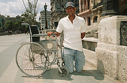 Man with disability; who has had both legs amputated at the knee and is wheelchair user; in Havana; Cuba,