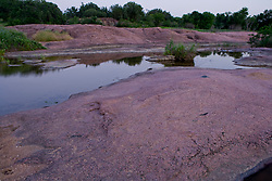 Stock photo of the pink granite boulders lining the banks of the Llano River in the Texas Hill Country