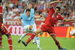 01.08.2013, Allianz Arena, Muenchen, Audi Cup 2013, FC Bayern Muenchen vs Manchester City, im Bild, Stevan JOVETIC (Manchester City) beim Torschuss, rechts Javier MARTINEZ (FC Bayern Muenchen) // during the Audi Cup 2013 match between FC Bayern Muenchen and Manchester City at the Allianz Arena, Munich, Germany on 2013/08/01. EXPA Pictures © 2013, PhotoCredit: EXPA/ Eibner/ Wolfgang Stuetzle<br /> <br /> ***** ATTENTION - OUT OF GER *****