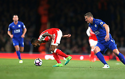 26 April 2016 London : Premier League Football : Arsenal v Leicester City :<br /> Theo Walcott of Arsenal gets a close look at the ball as he is challenged by Robert Huth.<br /> Photo: Mark Leech