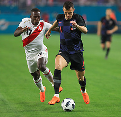 March 23, 2018 - Miami Gardens, Florida, USA - Croatia midfielder Ivan Perisic (4) drives the ball challenged by Peru defender Luis Advincula (17) during a FIFA World Cup 2018 preparation match between the Peru National Soccer Team and the Croatia National Soccer Team at the Hard Rock Stadium in Miami Gardens, Florida. (Credit Image: © Mario Houben via ZUMA Wire)
