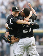 Chicago White Sox pitcher Mark Buehrle (L) and catcher Ramon Castro celebrate after beating the Tampa Bay Rays at U.S. Cellular Field in Chicago on July 23, 2009. Buehrle threw a perfect game in the Sox's 4-0 win. (UPI)
