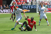 Manchester United Defender Eric Bailly tackles Real Madrid Forward Karim Benzema during the AON Tour 2017 match between Real Madrid and Manchester United at the Levi's Stadium, Santa Clara, USA on 23 July 2017.