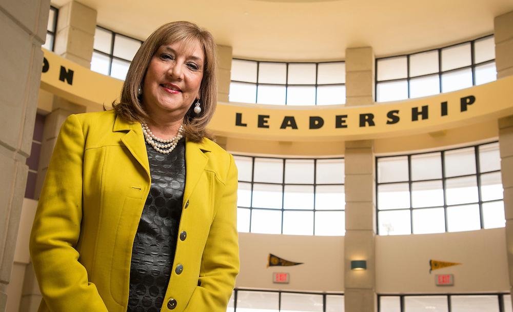Principal Noelia Longoria poses for a photograph at Ortiz Middle School, April 21, 2014.