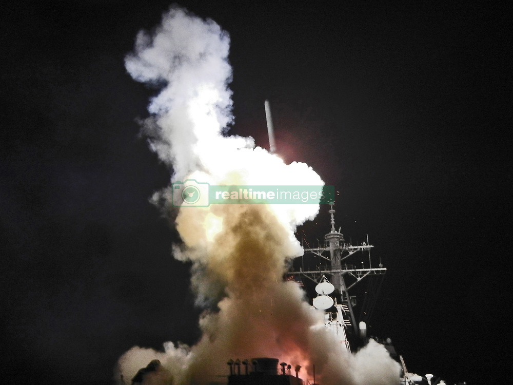 April 6, 2017 - *FILE PHOTO* - President Trump ordered a massive military strike on a Syrian air base in retaliation for a 'barbaric' chemical attack he blamed on Syria's President. Navy gun ships USS Porter and USS Ross targeted Shayrat Airfield in Syria, where planes that carried out the chemical attack where launched from. Pictured: Mar. 19, 2011 - Mediterranean Sea - The Arleigh Burke-class guided-missile destroyer USS Barry (DDG 52) launches a TOMAHAWK MISSILE toward a target in Libya in support of Operation Odyssey Dawn. This was one of approximately 110 cruise missiles fired from U.S. and British ships and submarines that targeted about 20 radar and anti-aircraft sites along Libya's Mediterranean coast. (Credit Image: © ICFN Roderick Eubanks/Navy Visual News Service/ZUMApress.com)