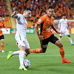BRISBANE, AUSTRALIA - FEBRUARY 21: Tristan Do of Muangthong United and Dane Ingham of the Roar in action during the Asian Champions League Group Stage match between the Brisbane Roar and Muangthong United FC at Suncorp Stadium on February 21, 2017 in Brisbane, Australia. (Photo by Patrick Kearney/Brisbane Roar)