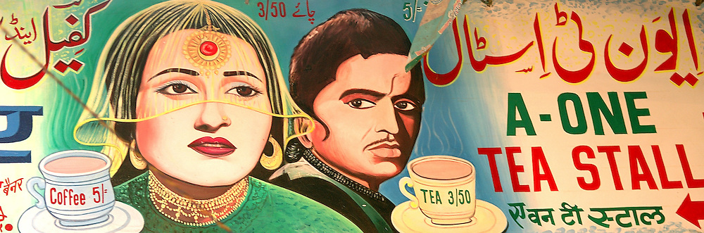 A shop sign outside a coffee shop in old Delhi