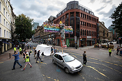 © Licensed to London News Pictures. 30/08/2019. Manchester, UK. Extinction Rebellion block roads during the rush hour , in Manchester City Centre , at the start of several days of planned disruption organised by environmental campaigners . Manchester City Council has declared a climate emergency but activists say the council's development plans do not reflect this . Photo credit: Joel Goodman/LNP