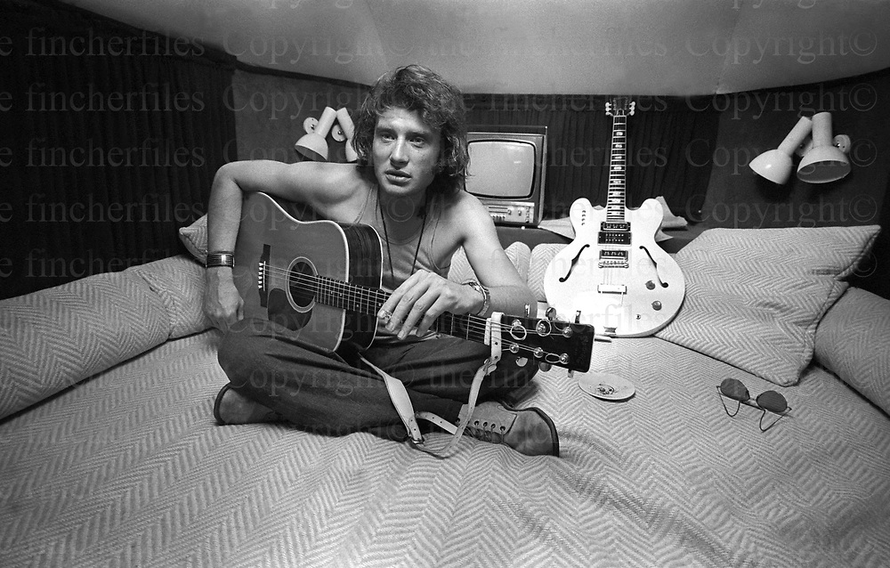 French rock star Johnny Halladay seen in his caravan during his 'Circus' concert tour in 1972.Photograph by Terry Fincher