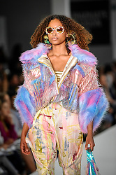 © Licensed to London News Pictures. 03/06/2018. LONDON, UK.  A model presents a look by Alexandra Terris from Solent University on the opening day of Graduate Fashion Week taking place at the Old Truman Brewery in East London.  The event presents the graduation show of up and coming fashion designers from UK and international universities.  Photo credit: Stephen Chung/LNP