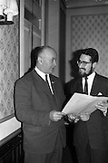 """23/03/1963<br /> 03/23/1963<br /> 23 March 1963<br /> Gaelic Sports Journalists Association Presentation off Awards at the Anchor Hotel, Dublin. Image shows  Mr. Hugh Byrne, President of the G.A.A. admiring the special certificate awarded to  film director Louis Marcus for his direction of the Wills/Gael - Linn Gaelic Football film, """"Peil""""."""