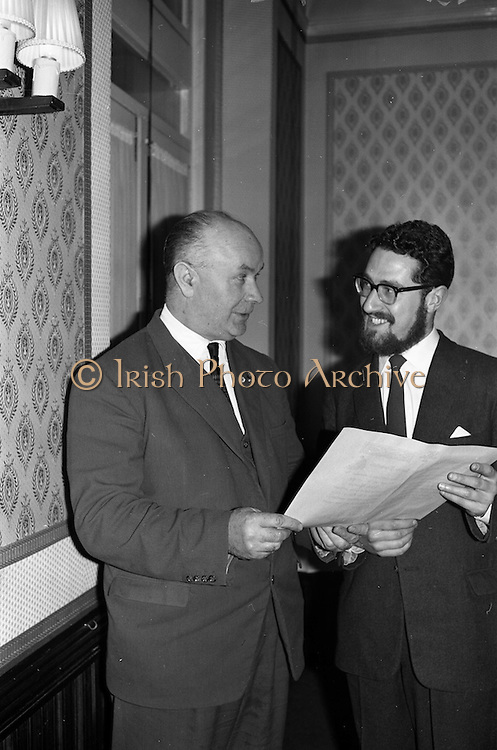 "23/03/1963<br /> 03/23/1963<br /> 23 March 1963<br /> Gaelic Sports Journalists Association Presentation off Awards at the Anchor Hotel, Dublin. Image shows  Mr. Hugh Byrne, President of the G.A.A. admiring the special certificate awarded to  film director Louis Marcus for his direction of the Wills/Gael - Linn Gaelic Football film, ""Peil""."