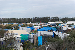 October 16, 2016 - Calais, France - Aerial view of the Calais Jungle, in Calais, France, on October 16, 2016. The refugee camp on the coast to the English Channel is to be cleared in the next few days, according to the French government. In the camp live around the 1000 refugees and wait for the possibility to travel further through the Eurotunnel to the UK. (Credit Image: © Markus Heine/NurPhoto via ZUMA Press)