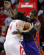 Jan 28, 2012; Houston, TX, USA; New York Knicks power forward Amare Stoudemire (1) steals the ball from Houston Rockets power forward Luis Scola (4) during the first quarter at the Toyota Center. The Rockets won 97-84. Mandatory Credit: Thomas Campbell-US Presswire