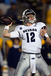 Nevada quarterback Carson Strong (12) drops back to pass against California during the third quarter of an NCAA college football game, Saturday, Sept. 4, 2021, in Berkeley, Calif. (AP Photo/D. Ross Cameron)