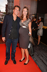 EMMA CROSBY and JEREMY PETERS at a party to celebrate the 21st anniversary of The Roar Group hosted by Jonathan Shalit held at Avenue, 9 St.James's Street, London on 21st September 2015.