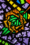 Stained glass depicting a palm branch and crown of thorns, leading to the crucifixion of Jesus Christ, on Tuesday, Aug. 24, 2021, at Grace Lutheran Church, Summerville, S.C. LCMS Communications/Erik M. Lunsford