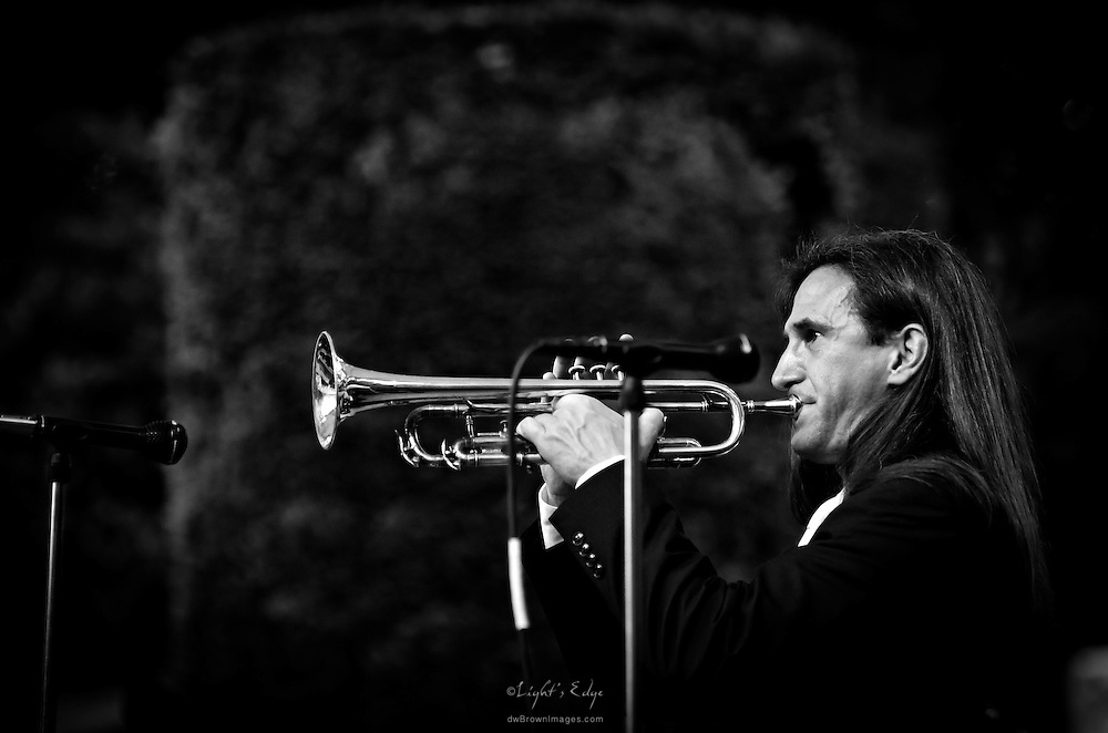 Gavin Bondy on trumpet with Pink Martini at an outdoor concert in Longwood Gardens in Kennett Square, PA.