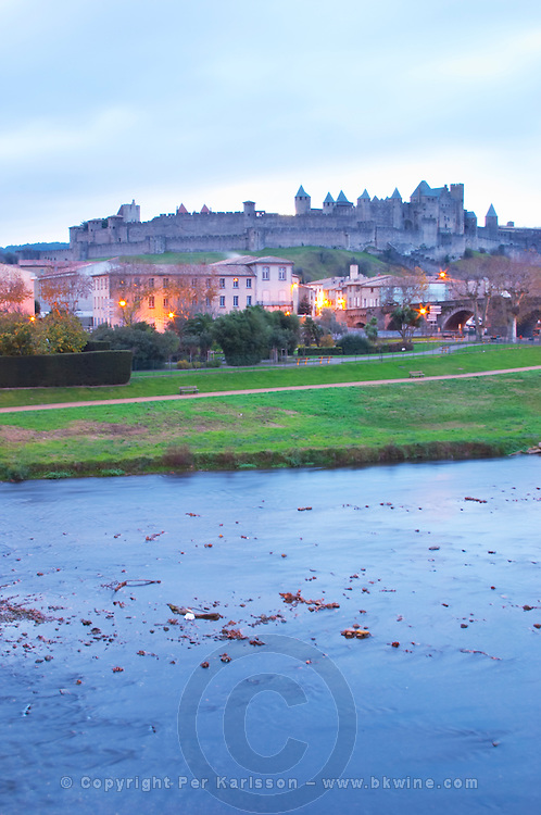 Carcassonne. Languedoc. View over the old city. Illuminated in early morning. A rainy and misty winter day. France. Europe.