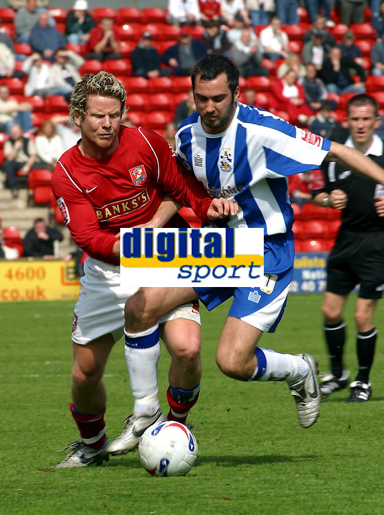 Photo: Dave Linney.<br />Walsall v Huddersfield Town. Coca Cola League 1. 22/04/2006Walsall's .Mads Timm(L) battles with Gary Taylor- Fletcher