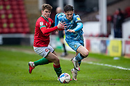 Forest Green Rovers Jake Young(18) battles for possession with Tom Leak of Walsall during the EFL Sky Bet League 2 match between Walsall and Forest Green Rovers at the Banks's Stadium, Walsall, England on 10 April 2021.
