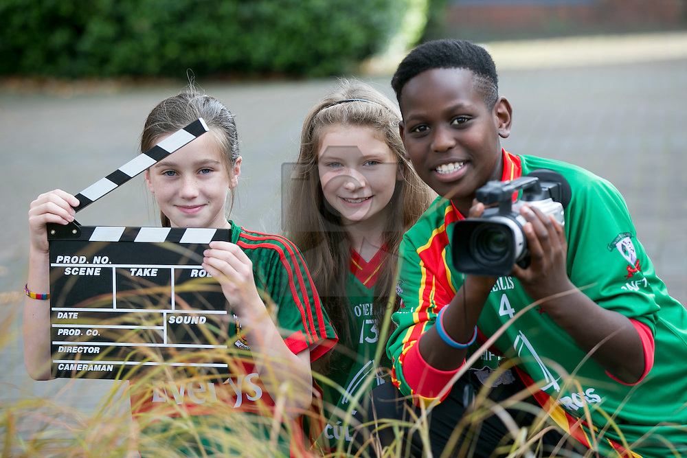 """Repro FRee: 03/11/2015 Pictured at the 11th FÍS Film Festival are students Elizabeth Loftus, Cadhla Shaw and Rasheed Momah from Scoil Raifteirí, who received the Award for 'An Scannán is Fearr as Gaeilge', for their film """"Bealach Glas"""", at a ceremony in the Helix, Dublin, 3 November."""