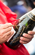 The Artemis Challenge at Aberdeen Asset Management Cowes Week 2014. <br /> Champagne Pol Roger signed by skippers.<br /> FREE for editorial use. Credit: Lloyd Images