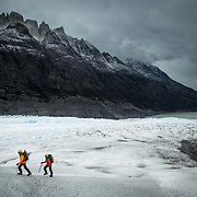 Two adventurers hiking on a glacier in Torres del Paine NP, Chile.