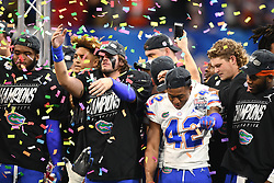 Florida Gators celebrate after winning the Chick-fil-A Bowl Game at  the Mercedes-Benz Stadium, Saturday, December 29, 2018, in Atlanta. ( AJ Reynolds via Abell Images for Chick-fil-A Kickoff)