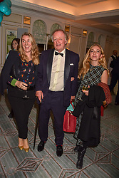 Laura Lopes, her father Andrew Parker Bowles and Ayesha Shand at the launch of the Fortnum & Mason Christmas & Other Winter Feasts Cook Book by Tom Parker Bowles held at Fortnum & Mason, 181 Piccadilly, London, England. 17 October 2018.