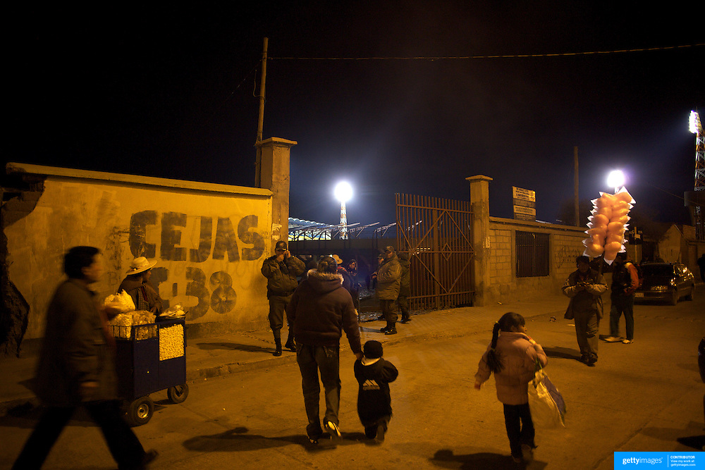 'Attitude at Altitude' Football in Potosi, Bolivia'..Food vendors outside the stadium as fans arrive for a night match between Real Potosi and Universitario Sucre at the Estadio Victor Agustin Ugarte, home of Bolivian football team Real Potosi. Real Potosi won the match 4-3. Potosi, Bolivia, 12th May 2010. Photo Tim Clayton....'Attitude at Altitude' Football in Potosi, Bolivia'..The Calvario players greet the final whistle with joyous celebration, high fives and bear hugs the players are sprayed with local Potosina beer after a monumental 3-1 victory over arch rivals Galpes S.C. in the Liga Deportiva San Cristobal. The Cup Final, high in the hills over Potosi. Bolivia, is a scene familiar to many small local football leagues around the world, only this time the game isn't played on grass but a rock hard earth pitch amongst gravel and boulders and white lines that are as straight as a witches nose, The hard surface resembles the earth from Cerro Rico the huge mountain that overlooks the town. .. Sitting at 4,090M (13,420 Feet) above sea level the small mining community of Potosi, Bolivia is one of the highest cities in the world by elevation and sits 'sky high' in the hills of the land locked nation. ..Overlooking the city is the infamous mountain, Cerro Rico (rich mountain), a mountain conceived to be made of silver ore. It was the major supplier of silver for the spanish empire and has been mined since 1546, according to records 45,000 tons of pure silver were mined from Cerro Rico between 1556 and 1783, 9000 tons of which went to the Spanish Monarchy. The mountain produced fabulous wealth and became one of the largest and wealthiest cities in Latin America. The Extraordinary riches of Potosi were featured in Maguel de Cervantes famous novel 'Don Quixote'. One theory holds that the mint mark of Potosi, the letters PTSI superimposed on one another is the origin of the dollar sign...Today mainly zinc, lead, tin and small quantities of silver are extracted from the mi