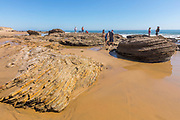 People Standing on Rocks at Crystal Cove State Beach