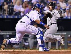 May 29, 2017 - Kansas City, MO, USA - Detroit Tigers' Jose Iglesias scores before the ball reaches Kansas City Royals catcher Salvador Perez on a two-run single by Miguel Cabrera in the eighth inning on Monday, May 29, 2017 at Kauffman Stadium in Kansas City, Mo. (Credit Image: © John Sleezer/TNS via ZUMA Wire)