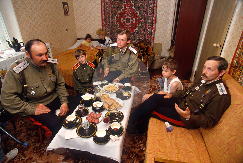 A family of Russian Don Cossacks have a family meal in their small apartment in Novocherkassk, Russia.