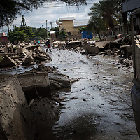 Mud and ruined furniture line a street in La Planeta, San Pedro Sula, Honduras, after hurricane Eta.<br /> <br /> Hurricanes Eta and Iota hit hard on the north coast of Honduras, leaving some areas flooded for three weeks, destroying people's furniture, belongings, vehicles and houses as well as standing crops.