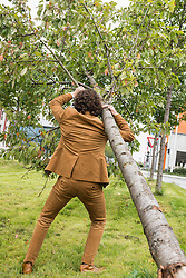 Businessman carrying fallen tree strength suit