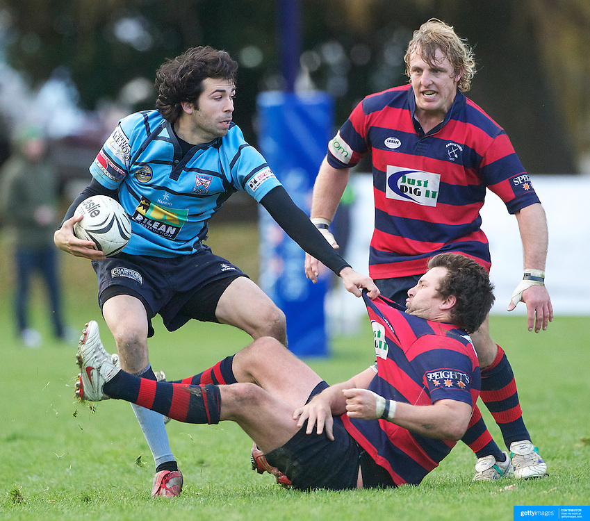 Richard Sim of Wakatipu evades the tackle of Rhys Chamberlain  during the Wakatipu V Arrowtown Rugby Match at Queenstown Recreation Ground,  Queenstown, South Island, New Zealand, 11th June 2011