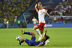June 25, 2018 - Kazan, Russia - Lukasz Teodorczyk of Poland and Wilmar Barrios of Colombia during the 2018 FIFA World Cup Group H match between Poland and Colombia at Kazan Arena in Kazan, Russia on June 24, 2018  (Credit Image: © Andrew Surma/NurPhoto via ZUMA Press)