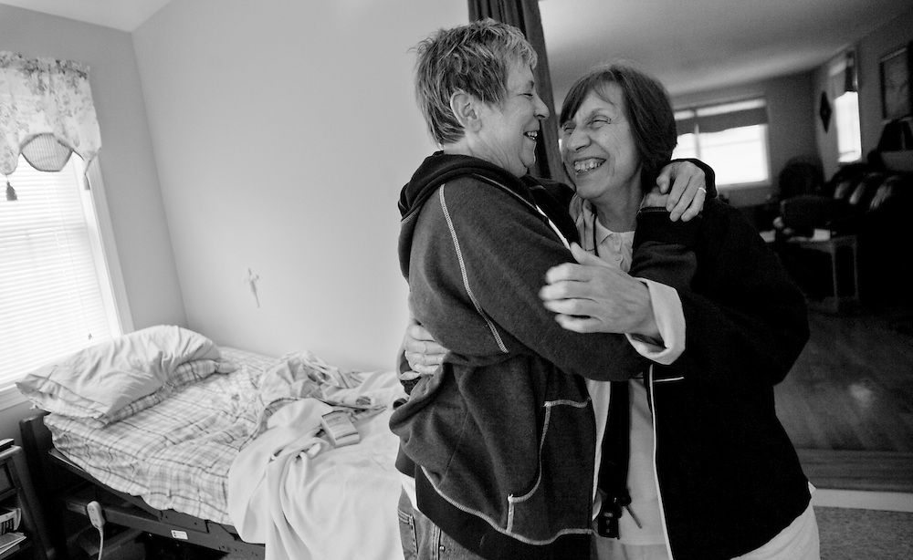 July 21, 2009 - Marie hugs her friend Diane Parady as Parady stopped in to drop off some food. Marie's health had become so weak that she decided to move her hospital bed back to her house in Middlebury, so that when it was time for her to die she would be close to friends and family. Marie died less than a month later, on Aug. 19, in a Rhode Island hospital as she was returning from a trip to the beach with her daughters for her 63rd birthday.