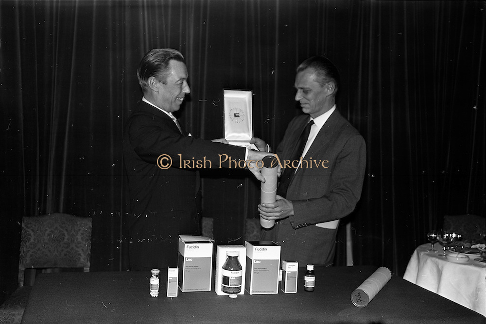 """17/12/1962<br /> 12/17/1962<br /> 17 December 1962<br /> Presentation of Packaging Awards at the Shelbourne Hotel, Dublin. Leo (Ireland) Ltd. had won the """"Eurostar"""" international award for packaging. Picture shows Mr. W.H. Walsh, General Manager of Coras Tractala and chairman of the Irish Packaging Institute, presenting the award to Mr. B. Schou Lund, Managing Director of Leo (Ireland) Ltd. at the event."""