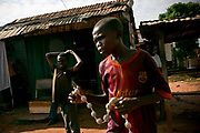 A boy sells a string of aphrodisiac near the Cameroonian border in Central African Republic.