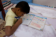 A young Egyptian boy practices his English words from a textbook at his home in the village of Bairat, on the West Bank of Luxor, Nile Valley, Egypt. In 2012, the literacy rate in Egypt was 75.2 per cent - specifically, male (83.2) and female (67.3). Not all state schools teach English as the second language but favour instead the old colonial French.