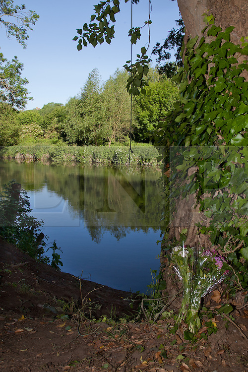 © London News Pictures. 31/05/11. Flowers left next to The River Medway at Stampers Park in Tovil, Maidstone where an 11-year old boy died after falling in yesterday (30/05/2011). Police said a courageous passer-by jumped into the swirling water to try to save the youngster but could not find him. Picture credit should read Manu Palomeque/London News Pictures.