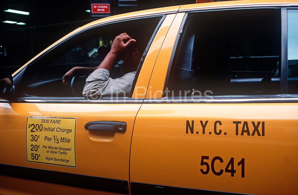 Fare prices and the arm of a New York City cab driver in Manhattan, on 21st September 2001, in New York, USA.