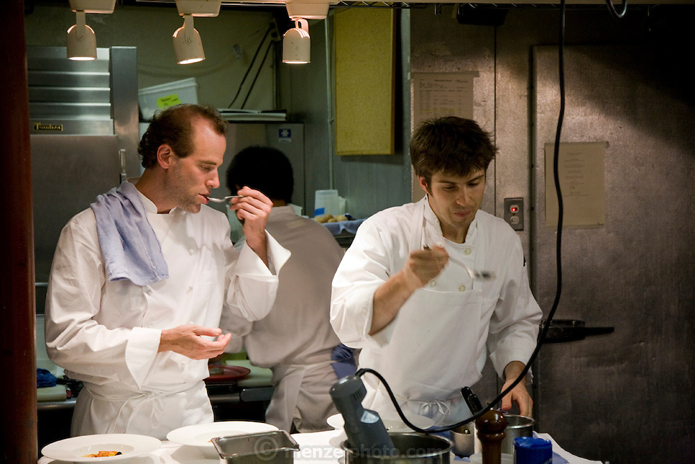 Chef Dan Barber (left) tastes food at his Blue Hills Restaurant in New York City.  (Chef Dan Barber is mentioned in the book What I Eat: Around the World in 80 Diets.)