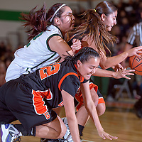 121413       Cable Hoover<br /> <br /> Gallup Bengals Kristen Quigley (22) and Shenoah Begay (21) get tangled with Thoreau Hawk Tia Tolth (12) as the chase the ball during the final of the Wingate Holiday Classic at Wingate High School Saturday.