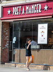 © Licensed to London News Pictures. 16/04/2020. London, UK. A women buys a takeaway coffee from Pret A Manger in St John's Wood, London which has reopened as Ministers decide when and how the lockdown will finish as politicians are warned that the UK could face the worst recession in 300 years. Photo credit: Alex Lentati/LNP