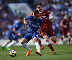 Chelsea's Eden Hazard and Liverpool's Andrew Robertson battle for the ball