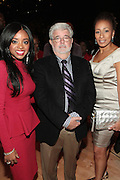 October 16, 2012-New York, NY : (L-R) Tamika Mallory, National Action Network Executive Director, Director George Lucas and Actress Tamara Tunie at the 3rd Annual National Action Network Triumph Awards held at Jazz at Lincoln Center on October 16, 2012 in New York City. The Triumph Awards were established by the National Action Network to recognize the contributions of humanitarians from all walks of life and to encourage future generations to drum majors for justice. (Terrence Jennings)